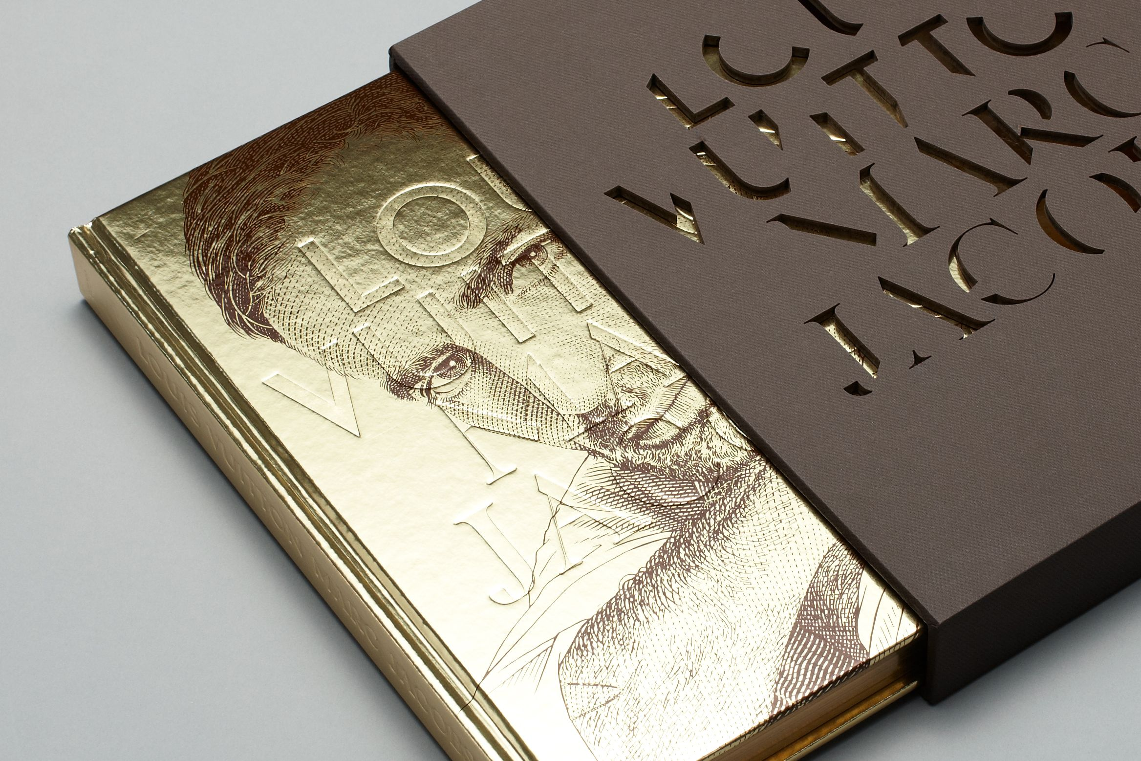 Image of Louis Vuitton Marc Jacobs book cover in gold foil with die cut slipcase