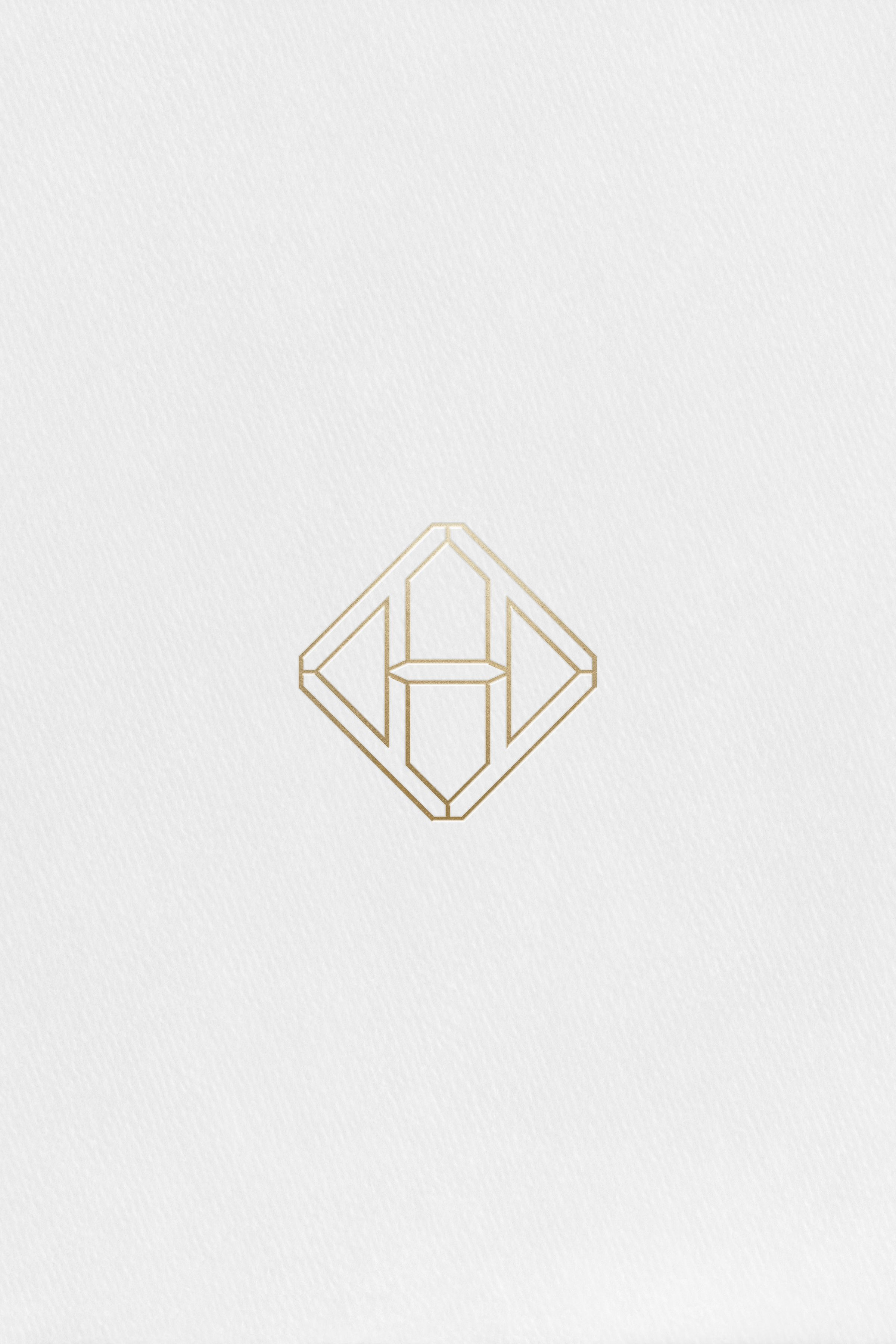 Hennessy H mark applied in gold foil to paper