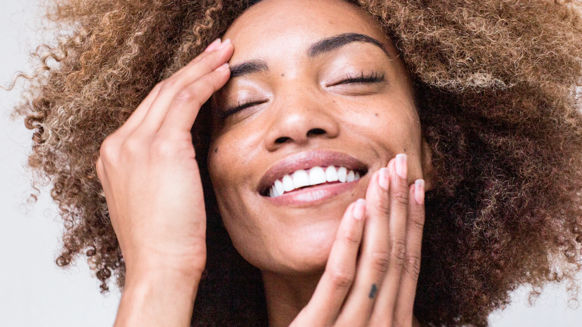 Woman with clear skin smiling