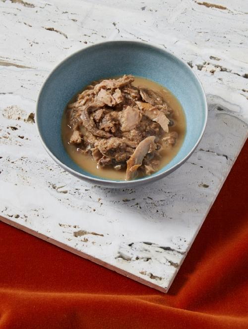 Cat Person tuna shreds in broth cat food in a bowl