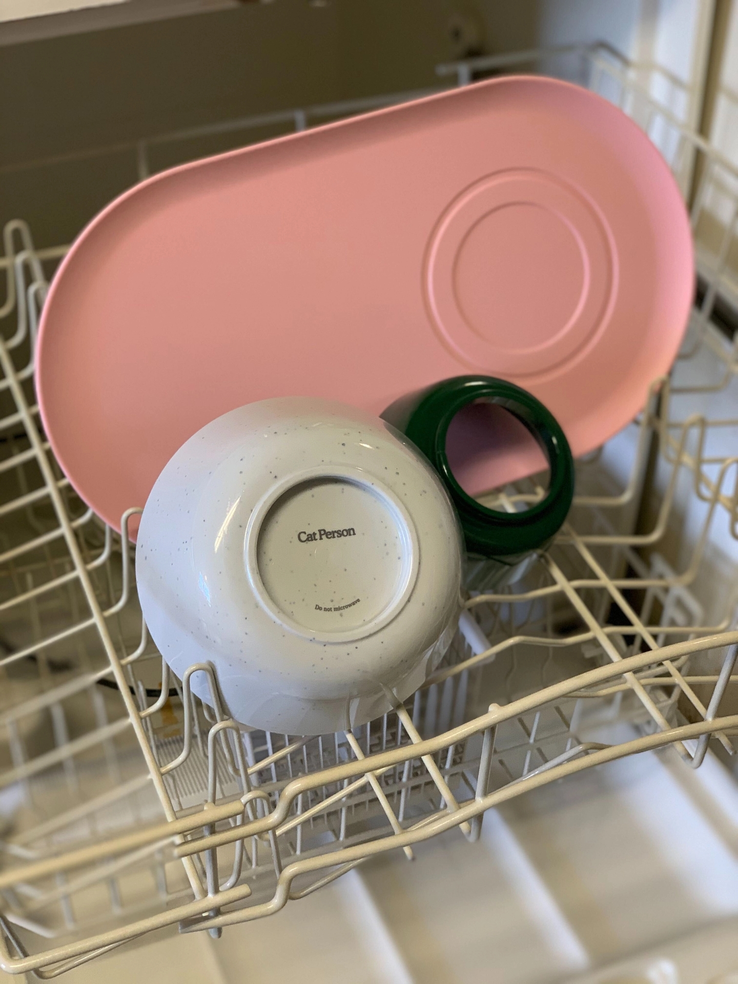 Cat Person Mesa Bowl components in the top rack of a dishwasher
