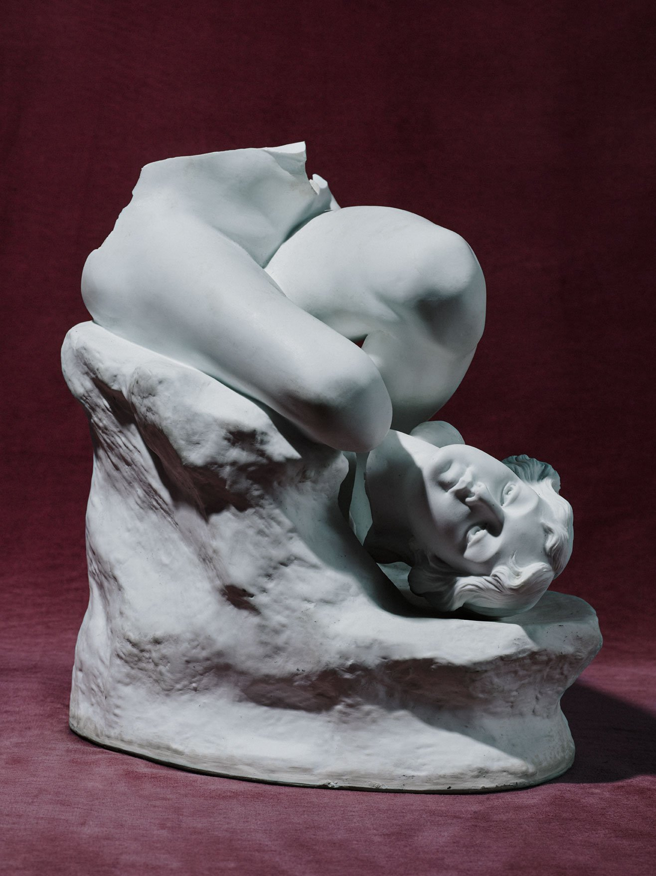 White sculpture of man, broken, for Romance Journal Issue 02. Publication design, art direction, print design by RoAndCo.
