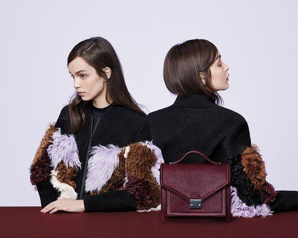 Models wear fringe jacket. Featuring maroon Loeffler Randall purse. Art Direction by RoAndCo