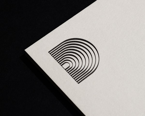 Downtown Music Group letterhead featuring custom secondary mark, designed by RoAndCo Studio