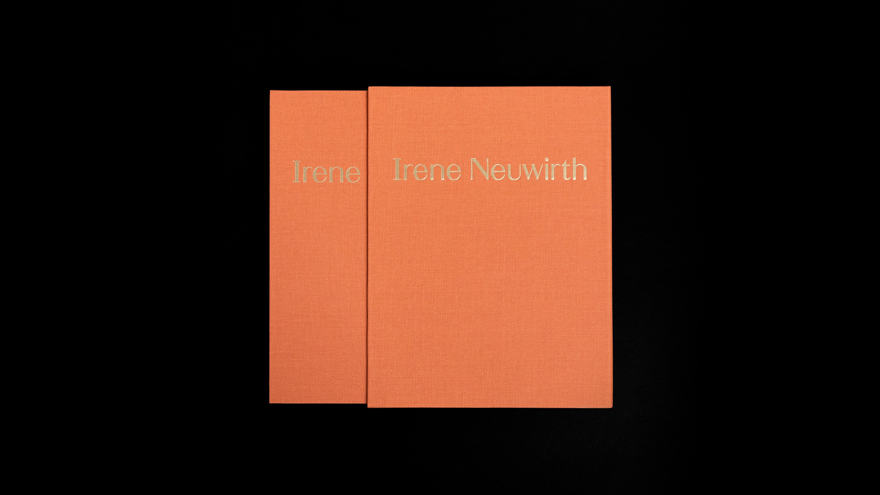 Irene Neuwirth brand book. Linen-bound, gold stamped, published by Proof 7. Irene Neuwirth gumball collection spread. Rings, necklaces, headpieces and earrings displayed on colored glasses. Art direction and print design by RoAndCo