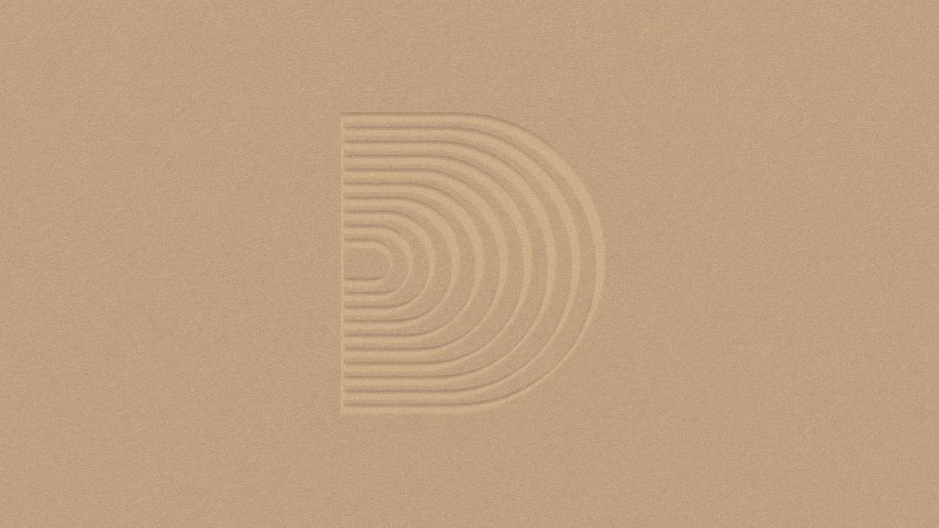 Downtown Music Group secondary mark embossed in gold on craft paper, print design by RoAndCo Studio