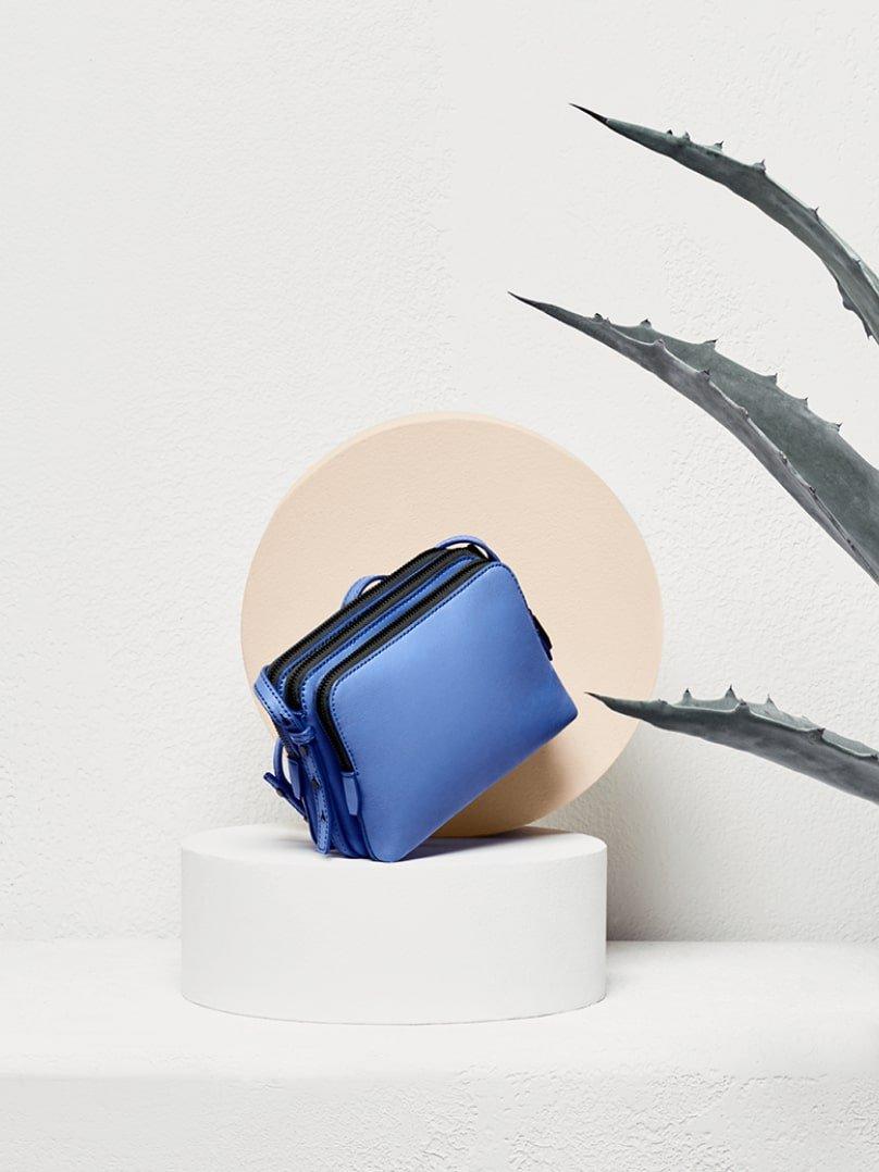 Light blue Loeffler Randall cross-body bag. Art direction by RoAndCo