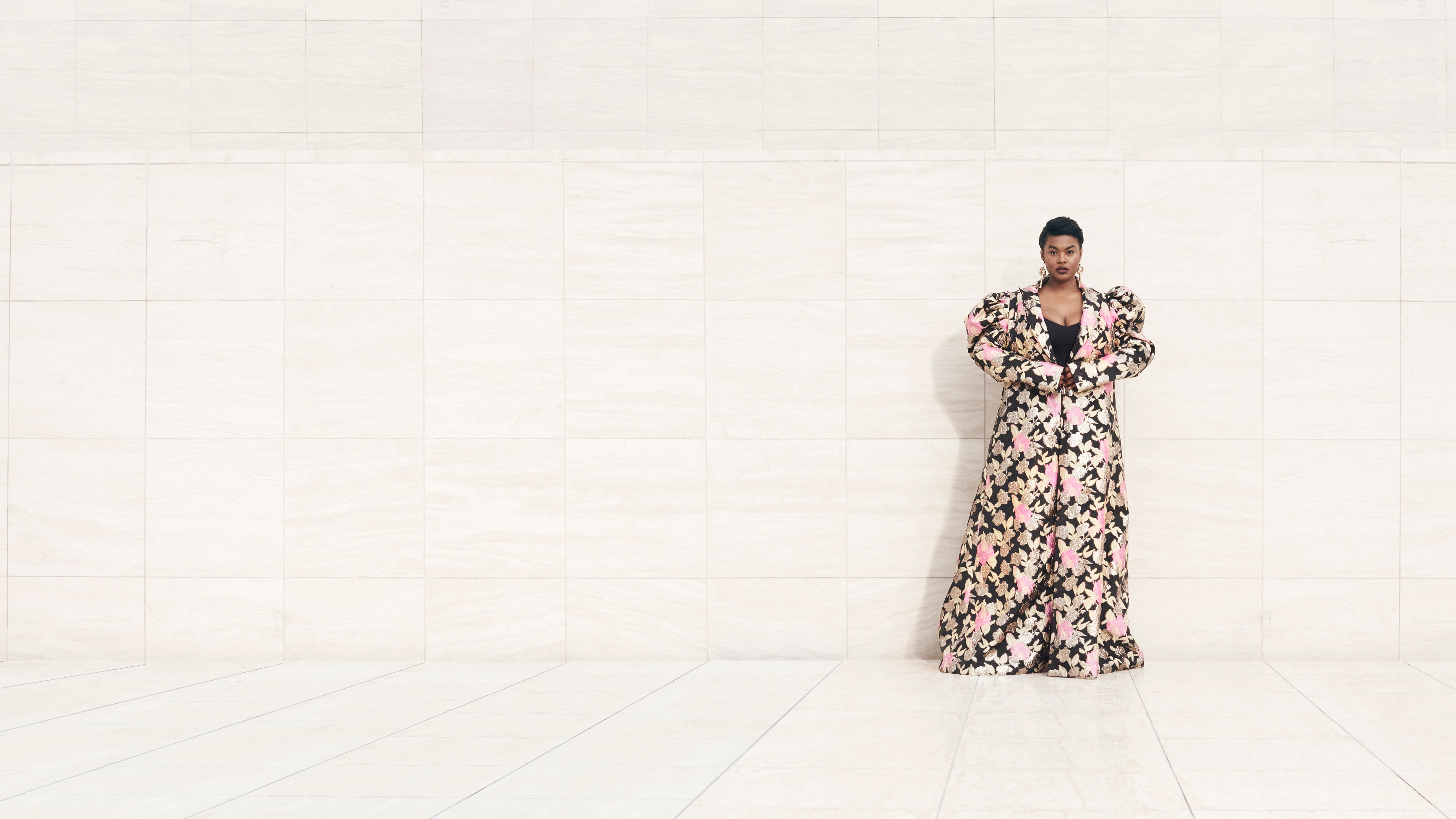 Model Precious Lee wearing floor length floral coat, Ad campaign. Art Direction by RoAndCo