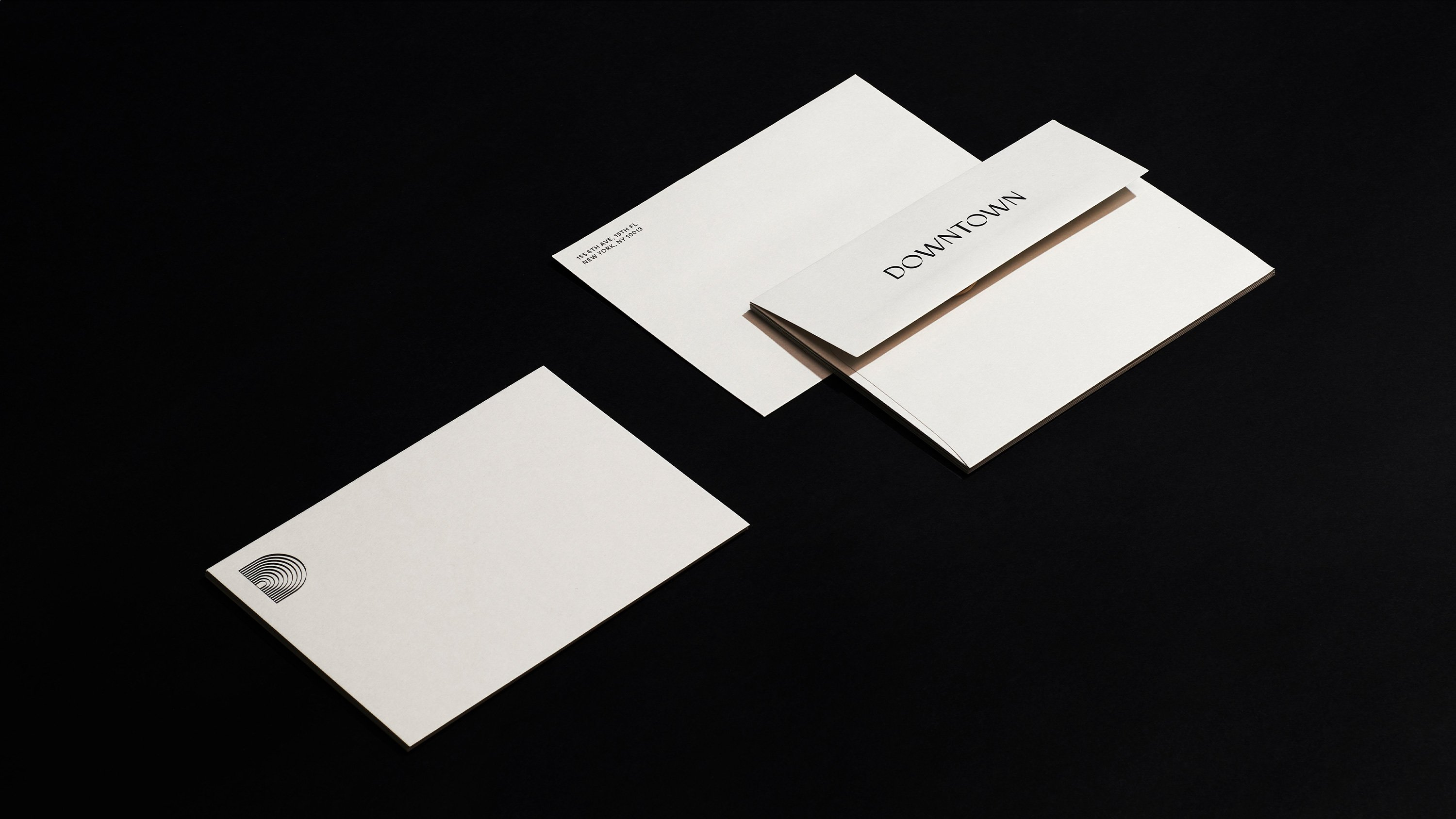 Downtown Music Group stationary envelopes in cream, print design by RoAndCo Studio