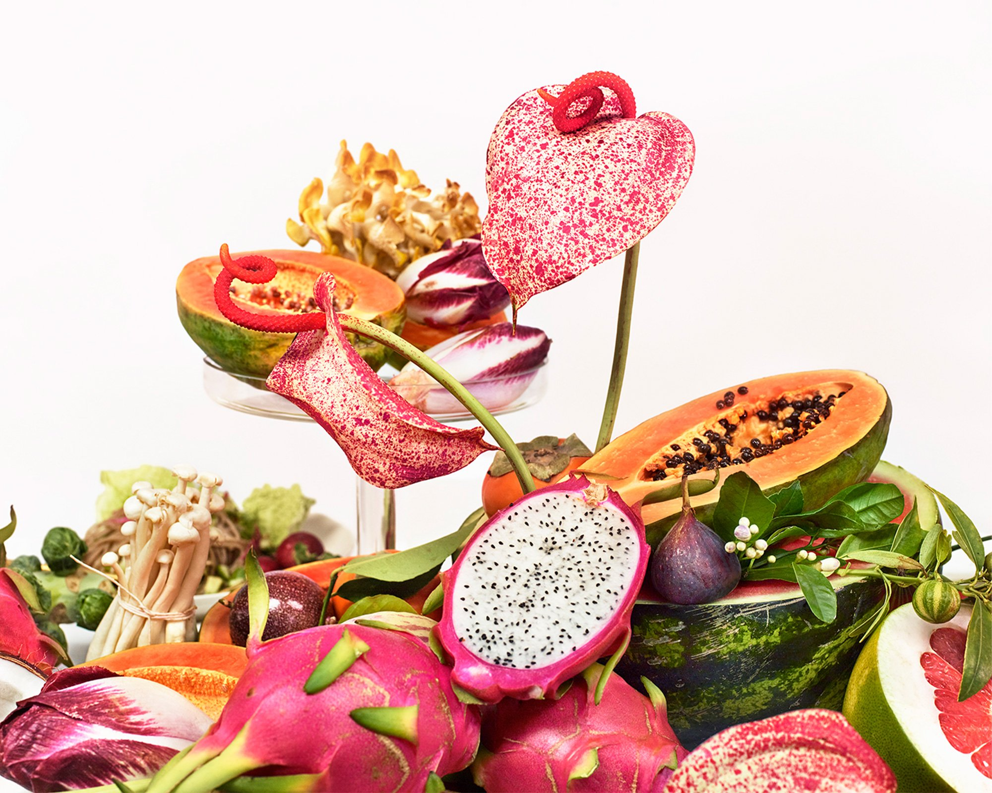 Close up of Sakara's table-scape. Dragonfruit, papaya, figs, and anthurium flowers help showcase clean and beautiful nutrition. Campaign Art direction by RoAndCo