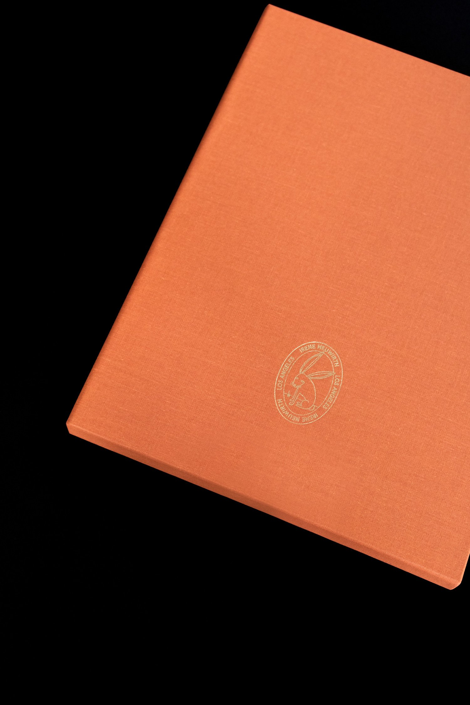 Close up of gold stamped bunny on the back of the Irene Neuwirth brand book. Art direction and print design by RoAndCo