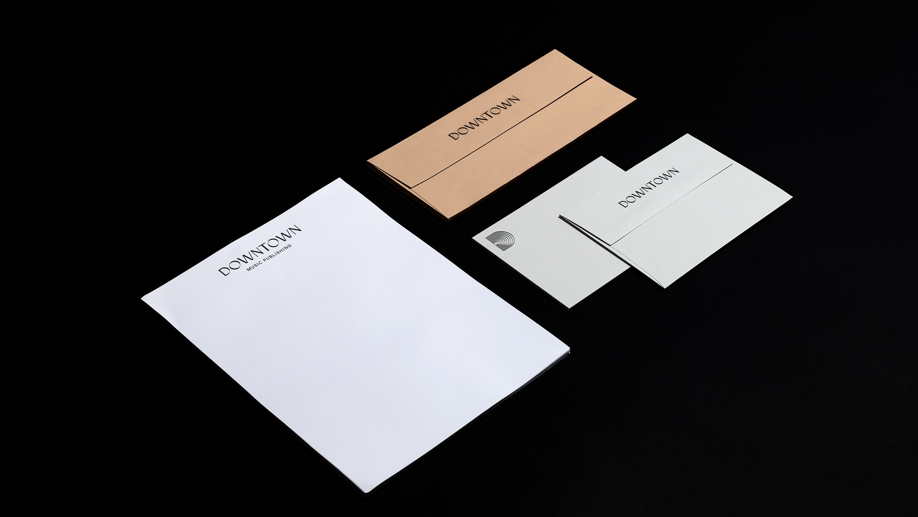 Downtown Music Group letterhead and matching envelopes, print design by RoAndCo Studio