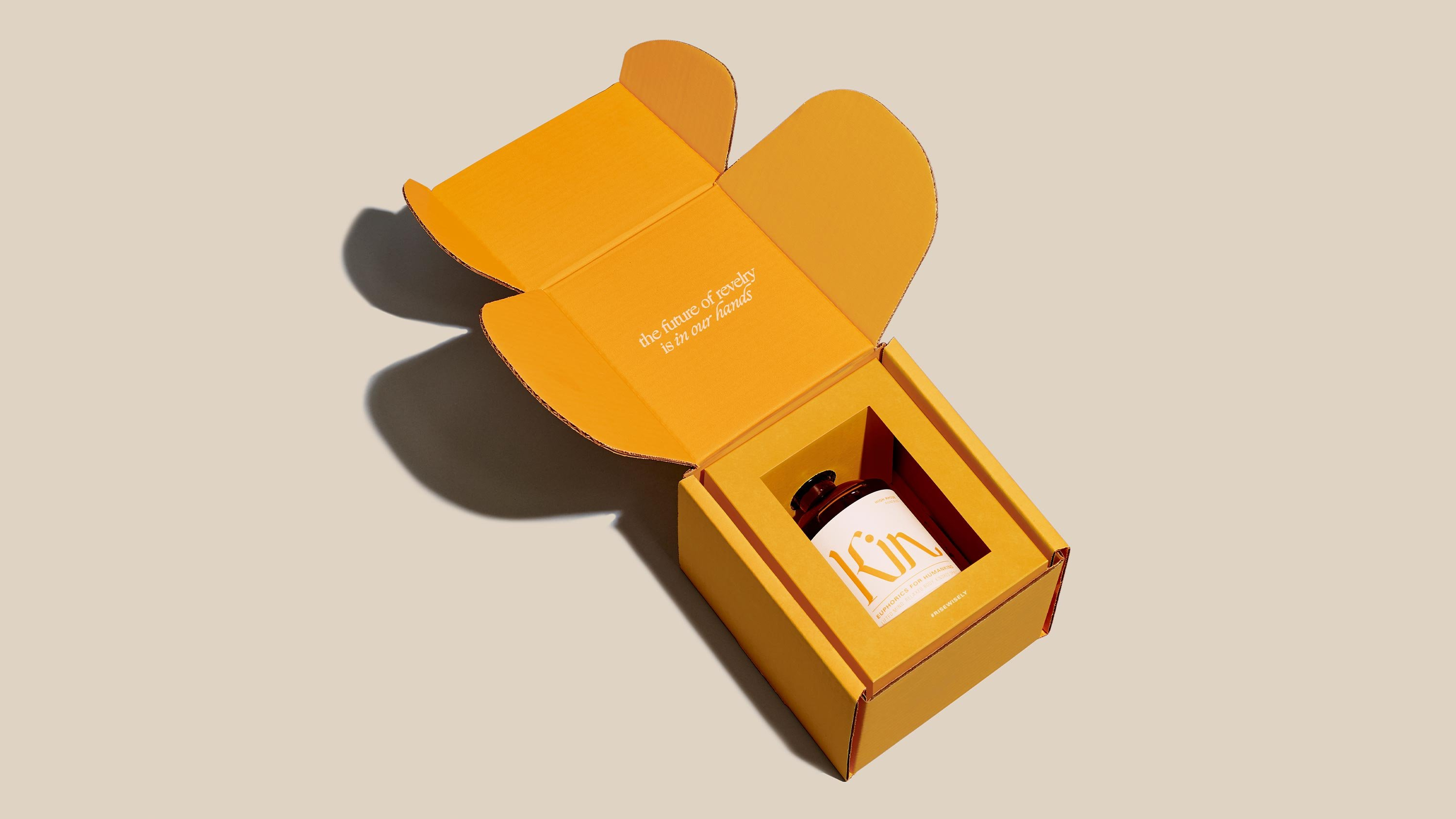 Kin Euphorics Packaging Design by RoAndCo, yellow box with bottle inside