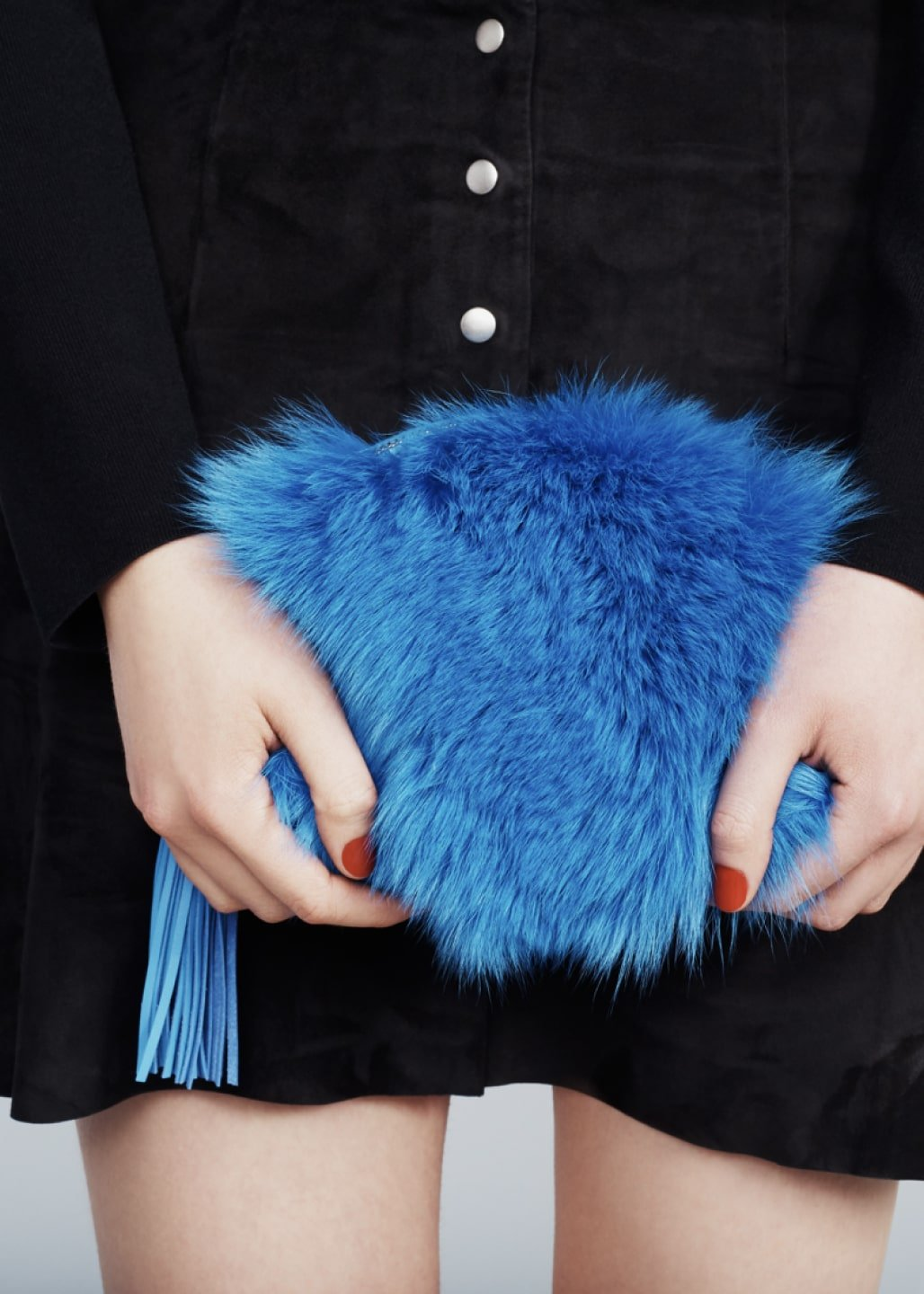 Close up of Loeffler Randall blue fur pouch. Art direction by RoAndCo