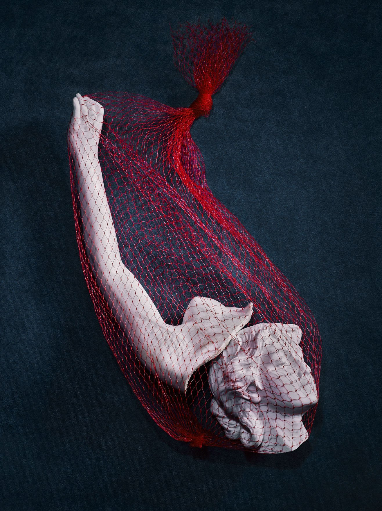Sculpture in red netting for Romance Journal Issue 02 resistance. Publication design, art direction, print design by RoAndCo.
