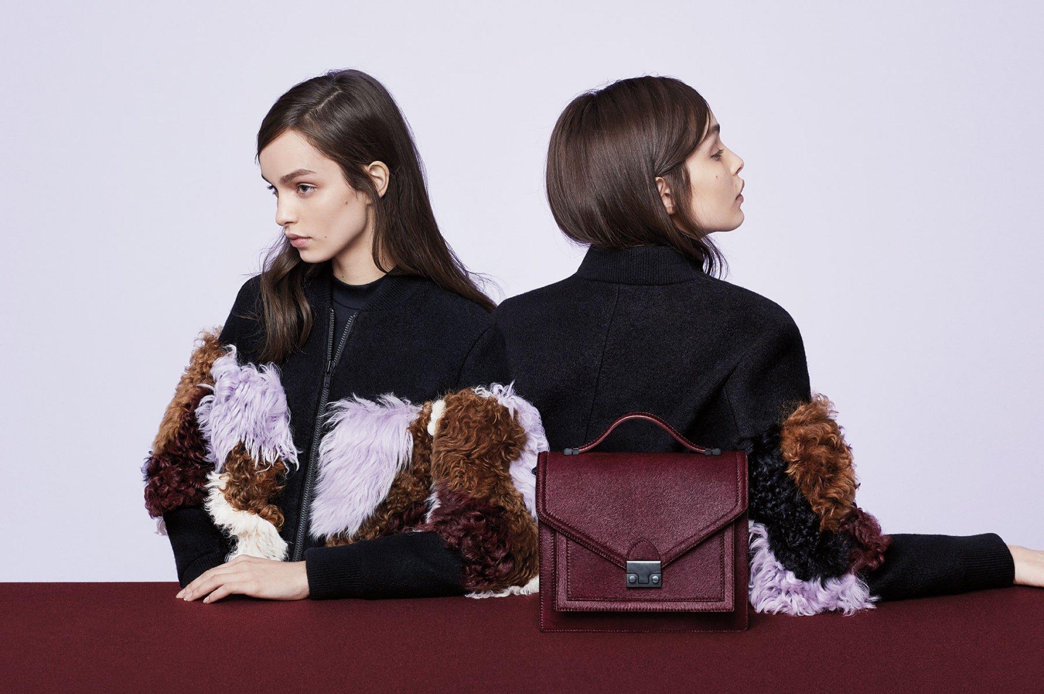 Models wearing fringe jacket featuring maroon Loeffler Randall purse. Art direction by RoAndCo