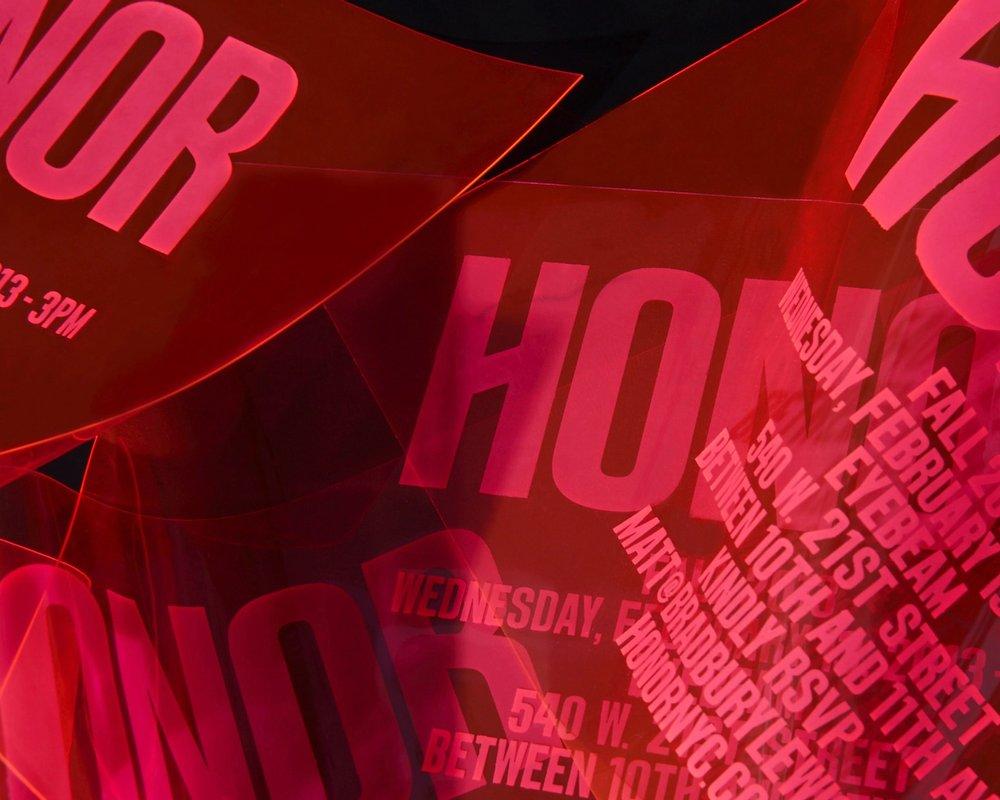 Red Honor logo on fashion show invitation, design by RoAndCo Studio