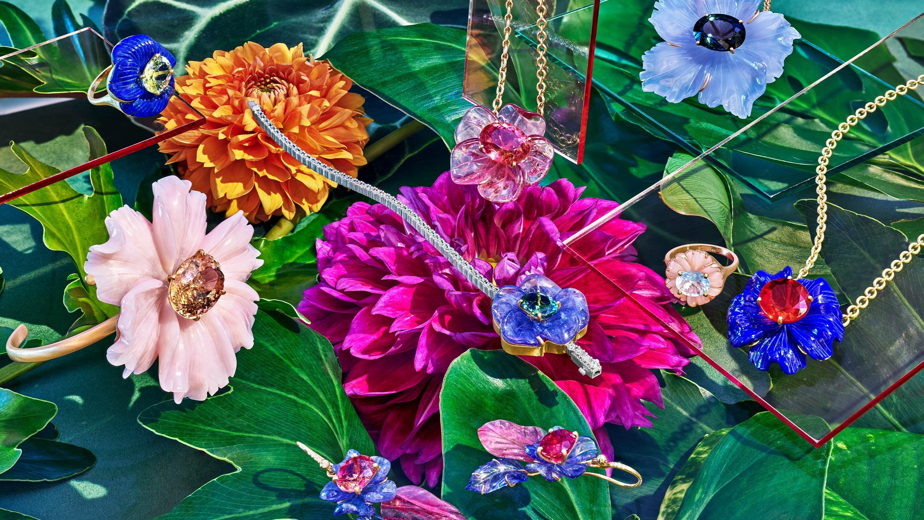 Irene Neurwirth jewelry in pink, purple, and gold atop florals creating a candy-colored garden scene. Art Direction by RoAndCo