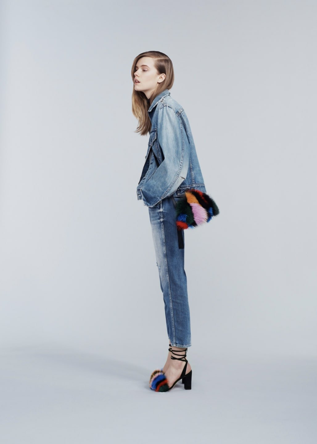 Model wearing jeans and jean jacket with Loeffler Randall peep-toe fur accented heels and matching purse. Art direction by RoAndCo
