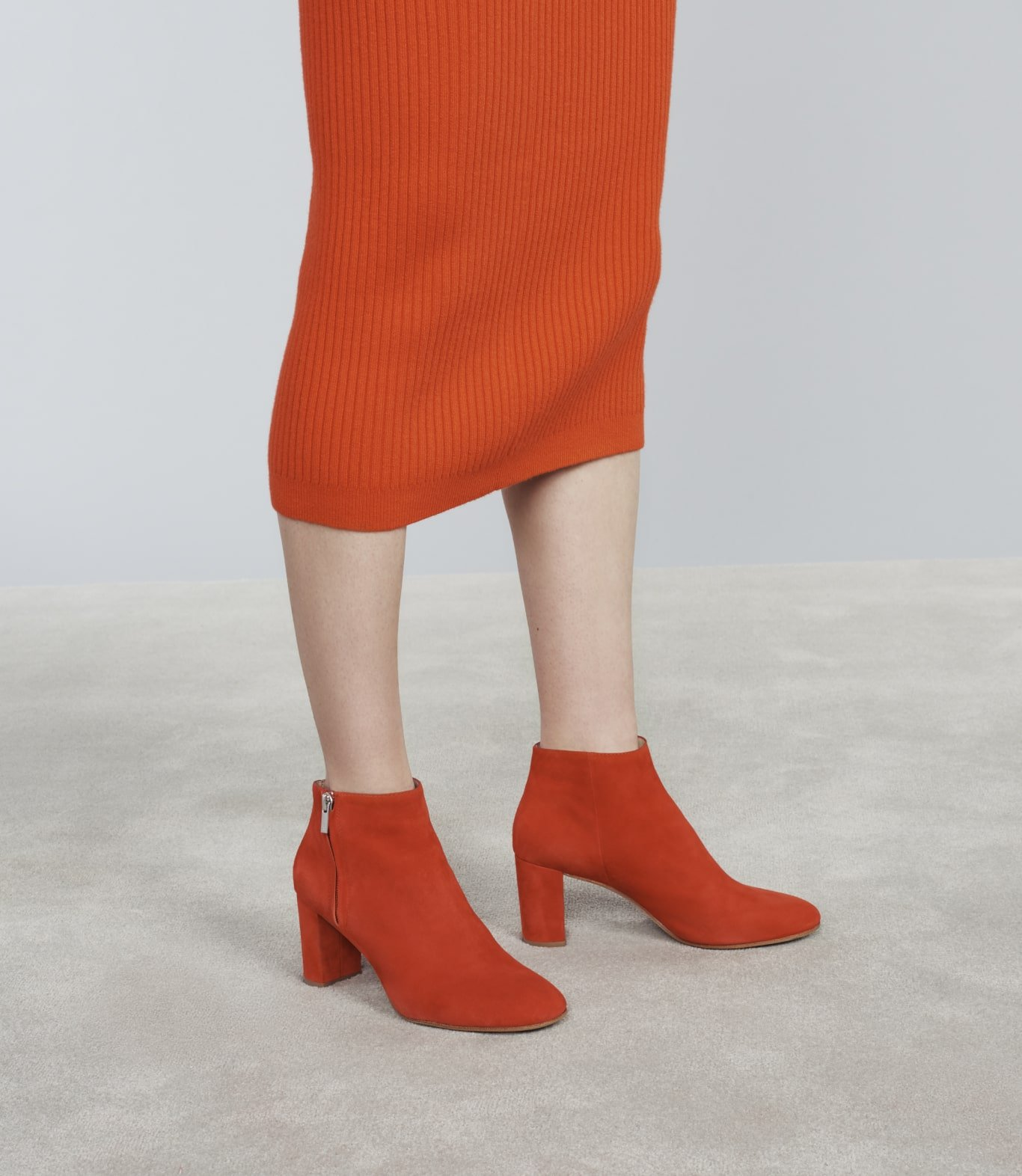 Close up of Loeffler Randall red heeled-suede-boots. Art direction by RoAndCo