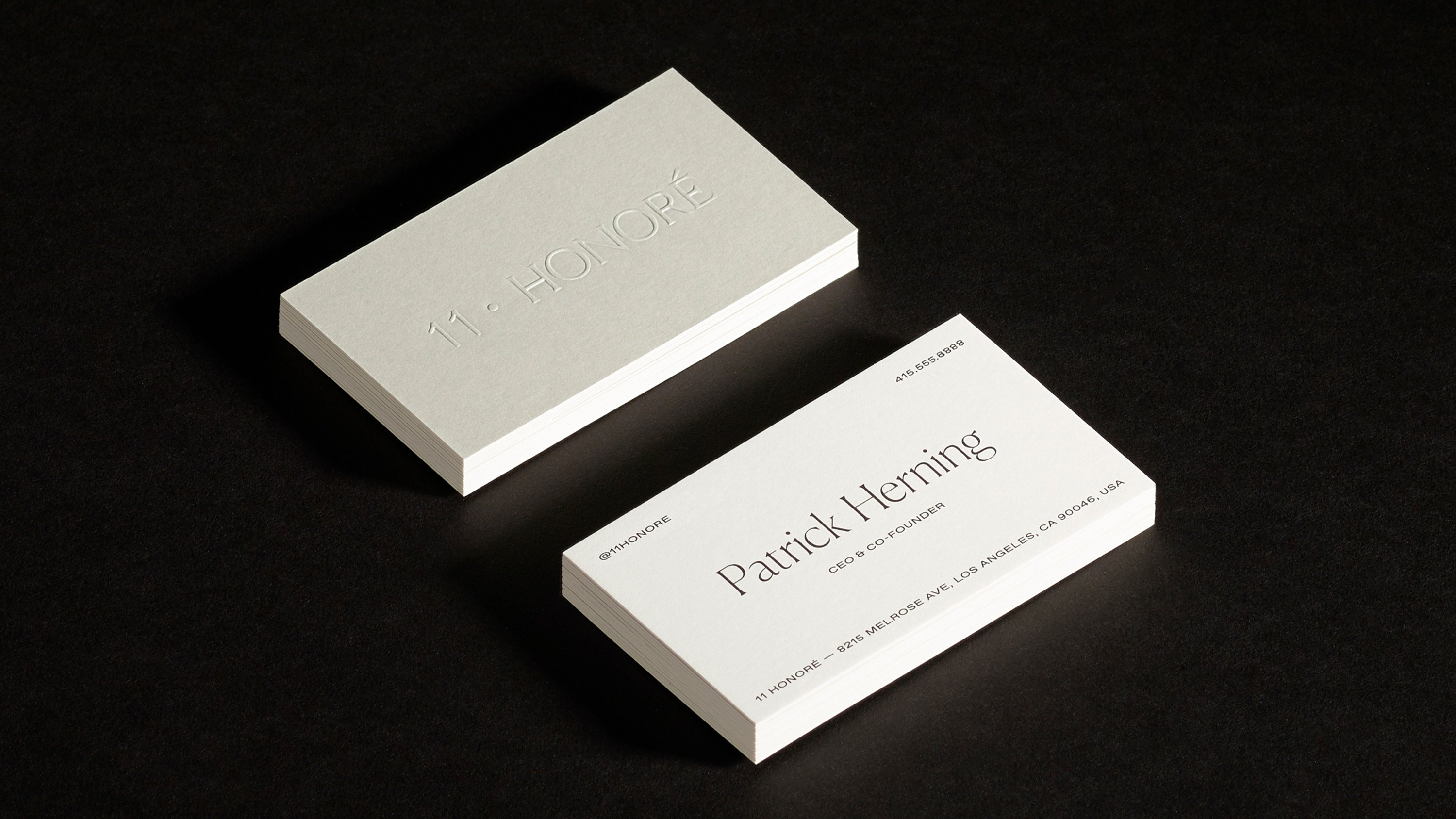 Close up of Patrick Herning custom embossed business card, print design and branding by RoAndCo