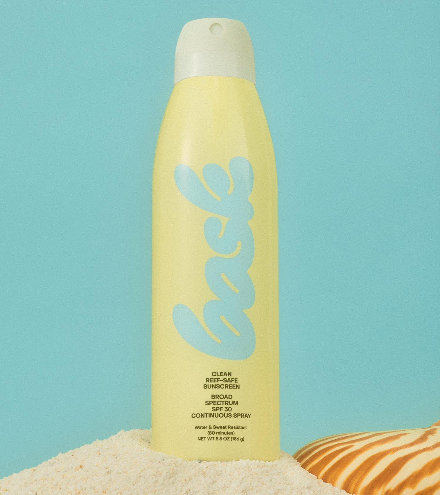 Bask Suncare Yellow Continuous Spray Sunscreen Bottle on Sand with Sea Shell on a Blue Background, Art Direction by RoAndCo