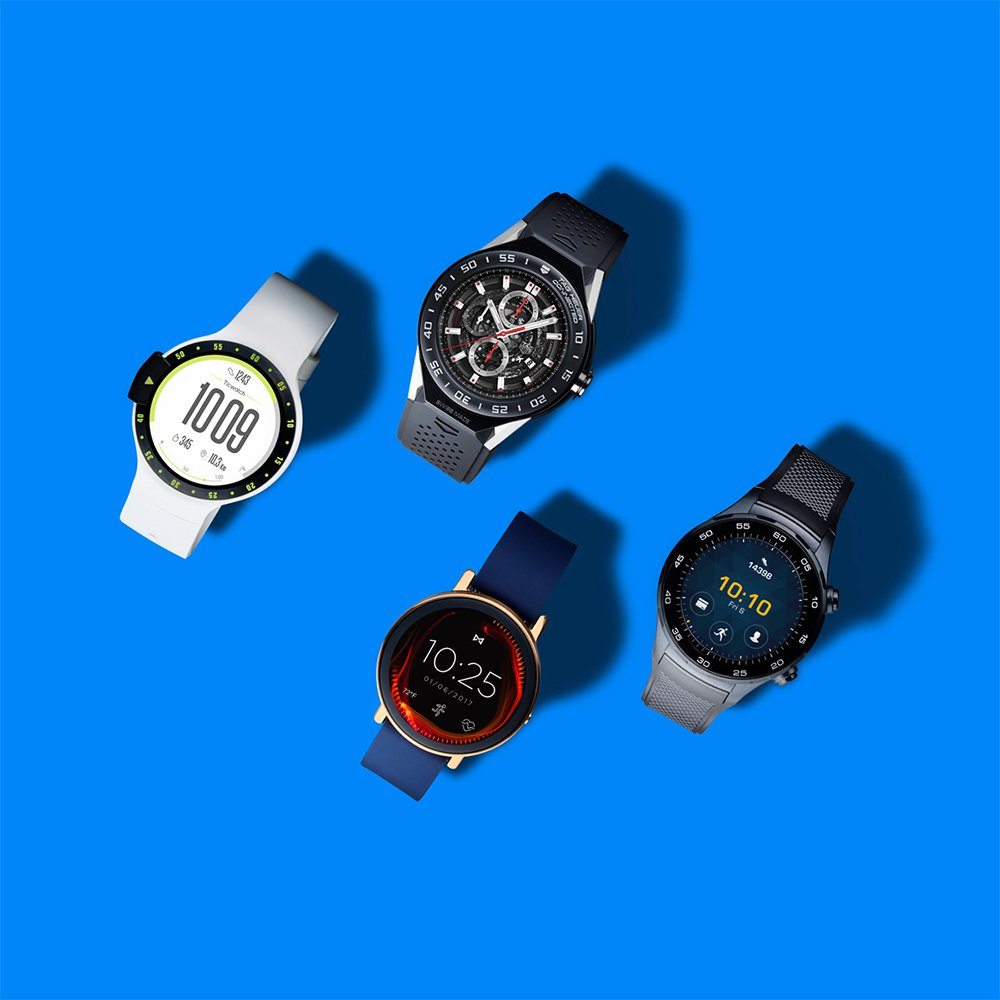 4 Google Wear OS watches in different styles on blue background, art direction by RoAndCo