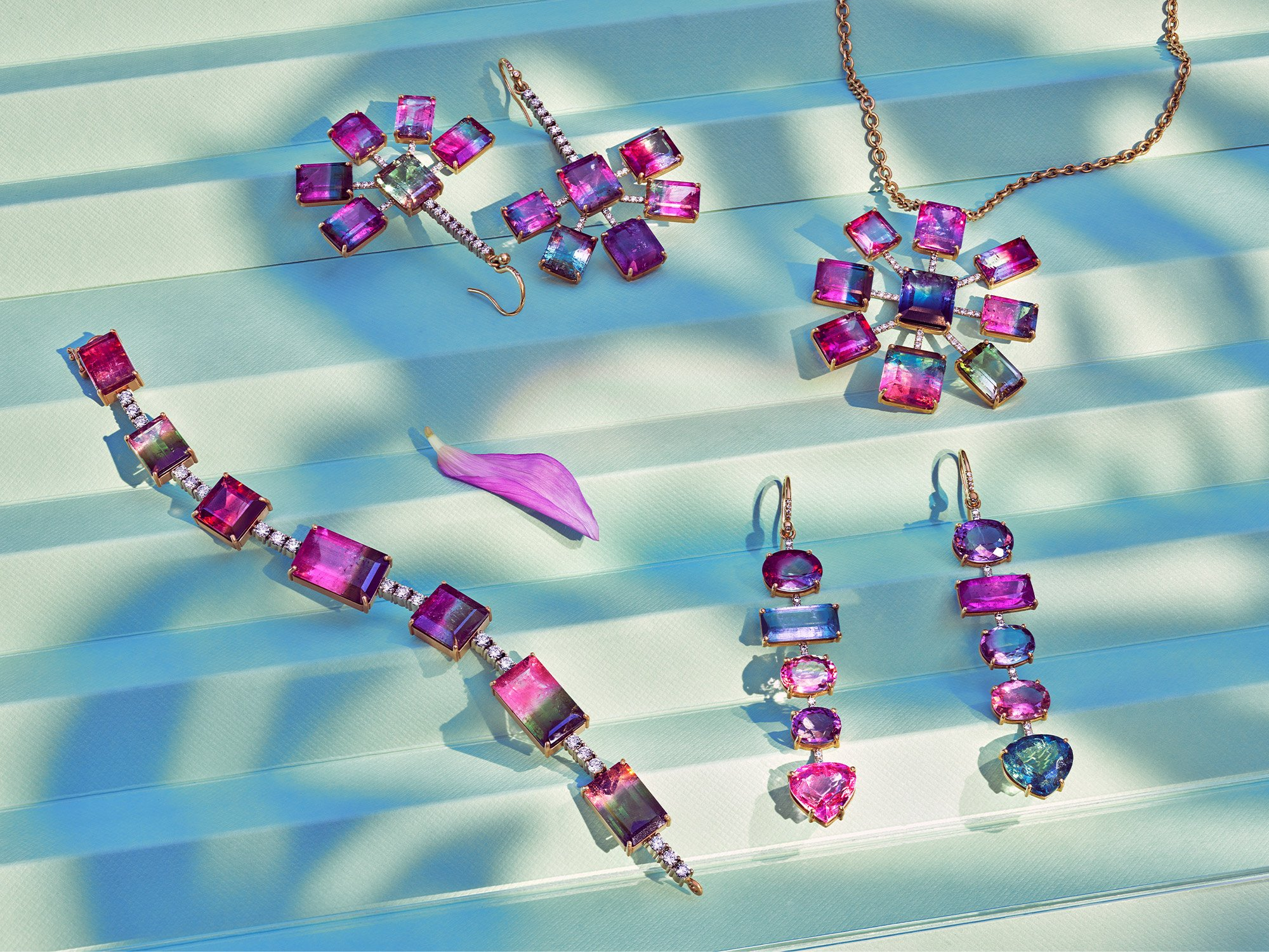 Irene Neuwirth Gemmy gems collection. Semi precious colorful stones resting on textured blue and white backdrop. Art direction by RoAndCo Studio