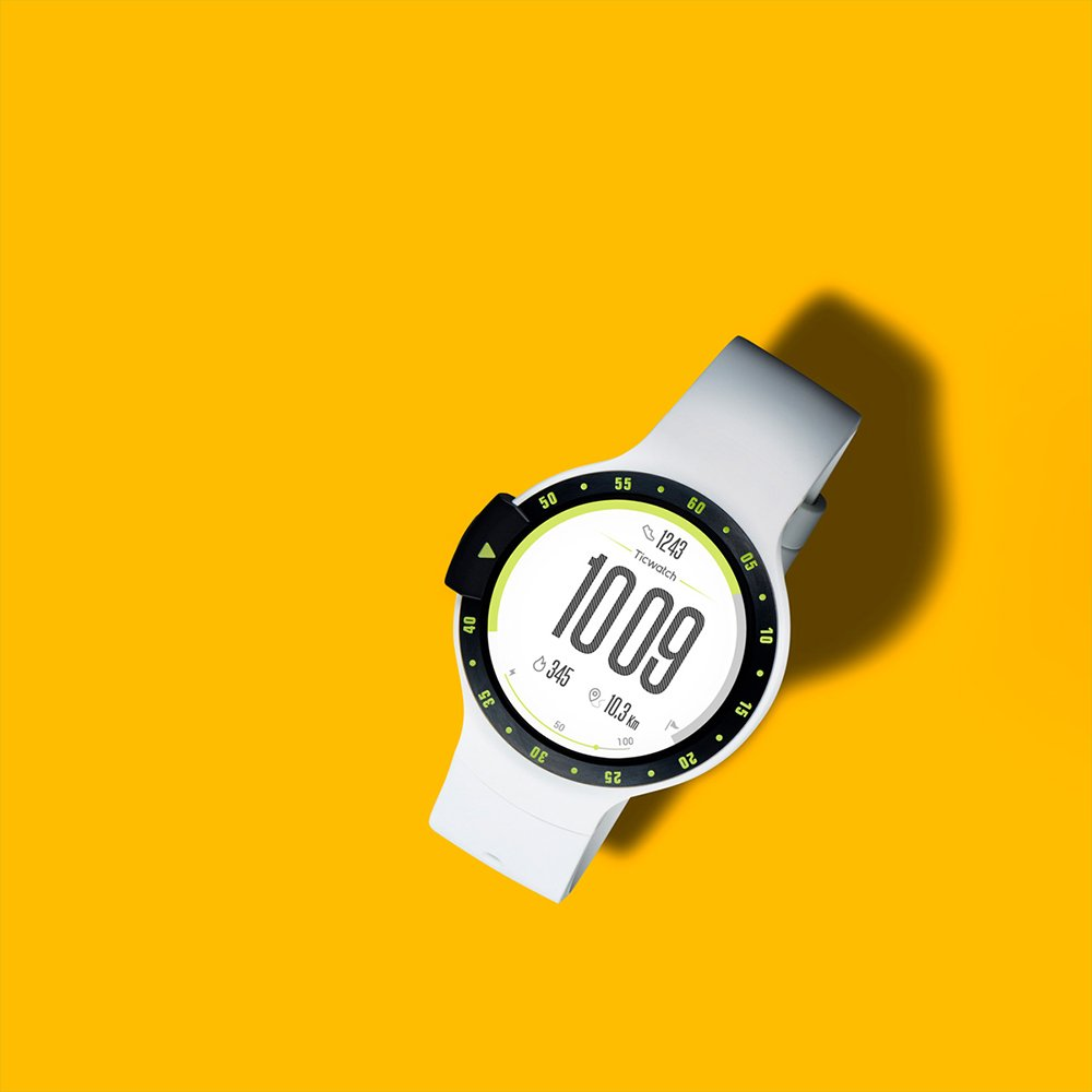 White Google Wear OS watch on yellow background, art direction by RoAndCo