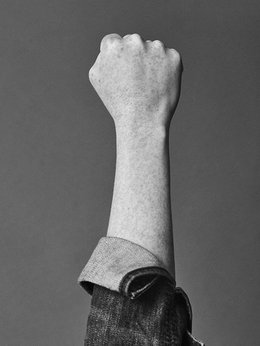Portrait of raised fist, a sign of resistance, for Romance Journal Issue 02. Publication design, art direction, print design, interviews by RoAndCo.