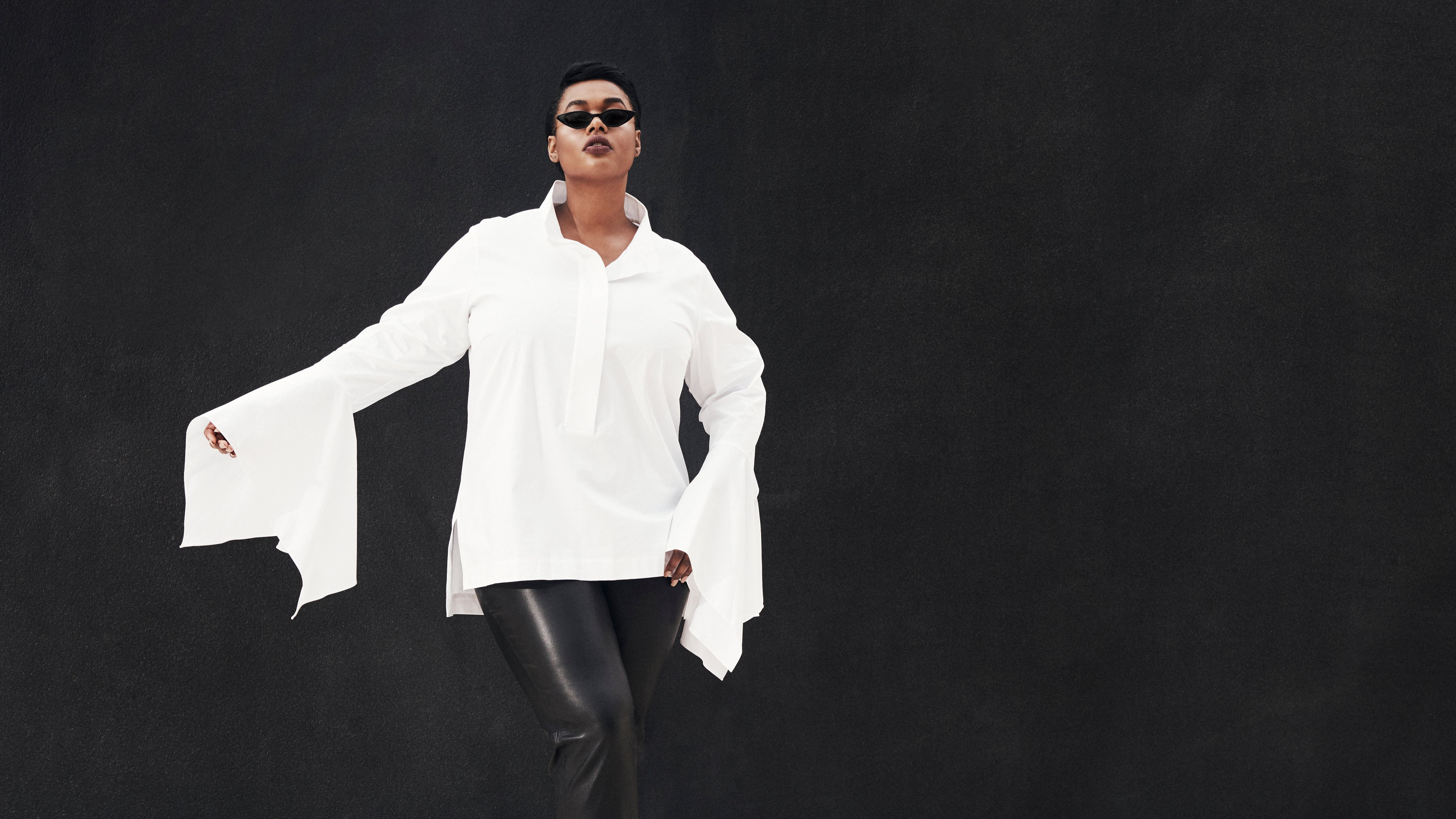 Model Precious Lee wearing white designer shirt and black sunglasses, Ad campaign. Art Direction by RoAndCo