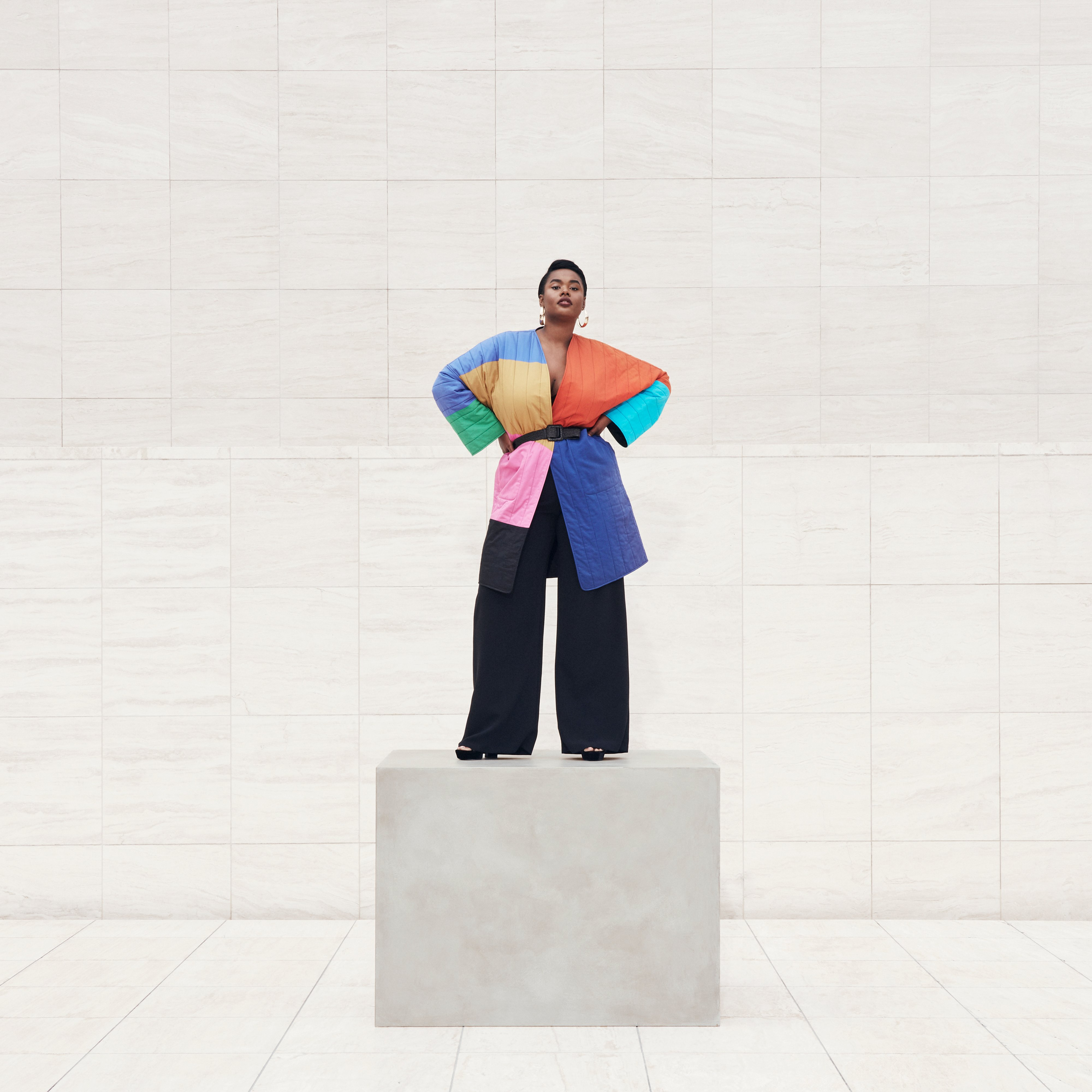 Model Precious Lee wearing color-blocked coat, Ad campaign. Art Direction by RoAndCo