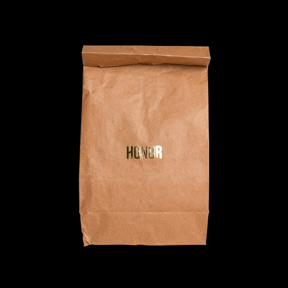 Honor brown paper bag with gold foil Logo, design by RoAndCo