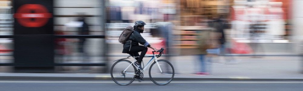 With Docker you have fast software delivery (like a bike delivery is the fastest in an urban area)