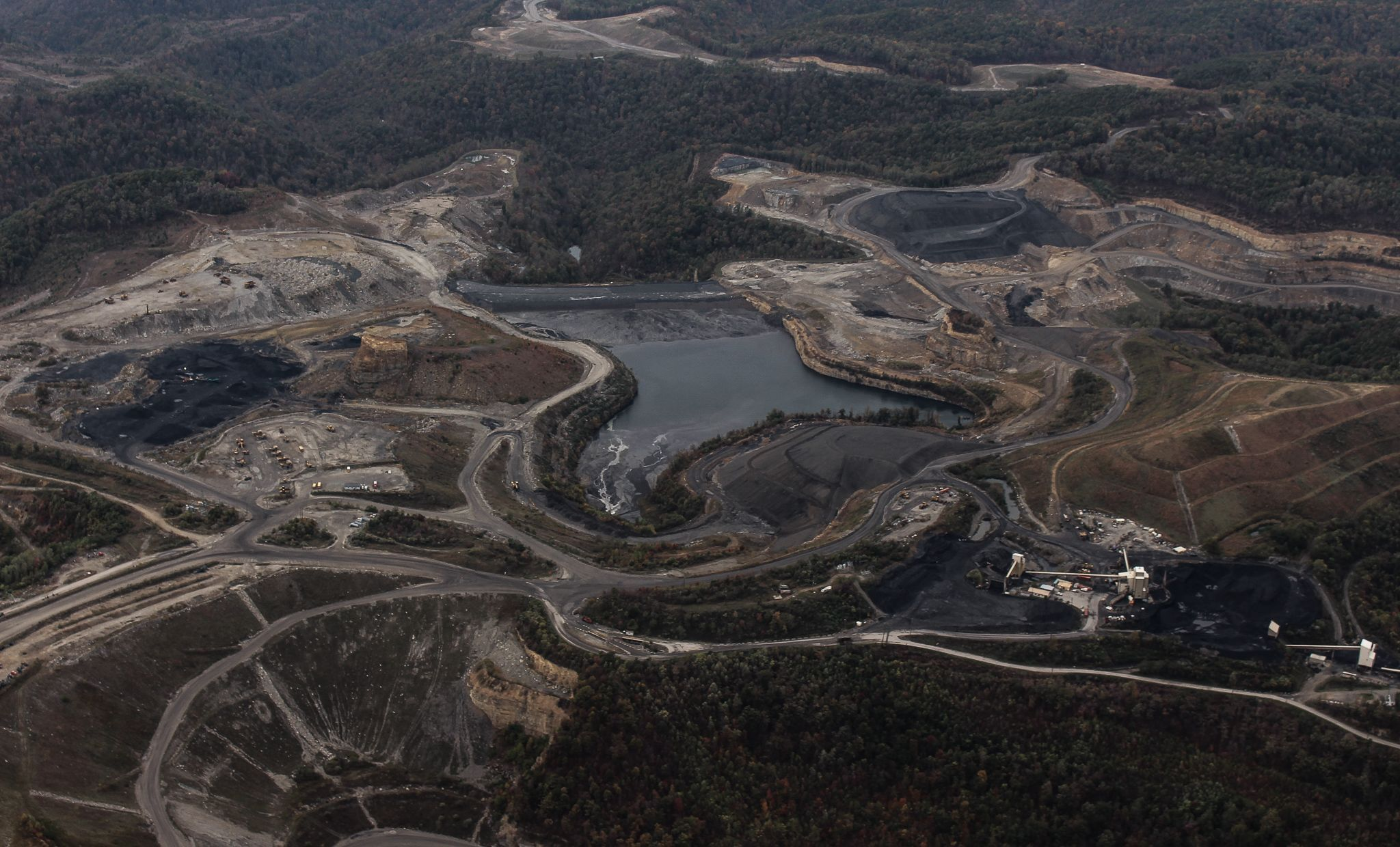 overhead shot of mountain top removal mining destruction