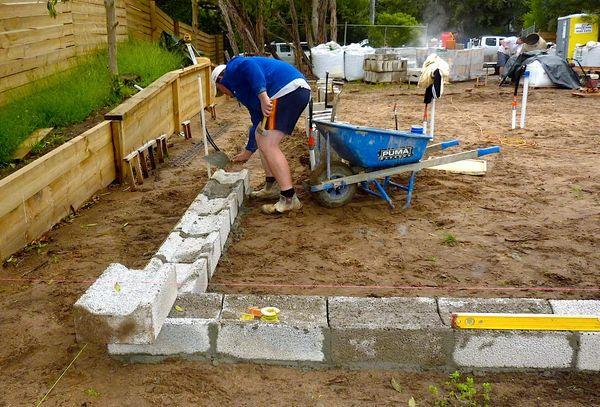 worker laying footing block using clinkaBLOK