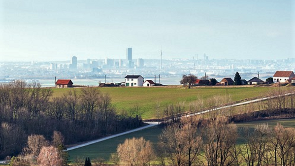 Countryside with a city landscape in the distance