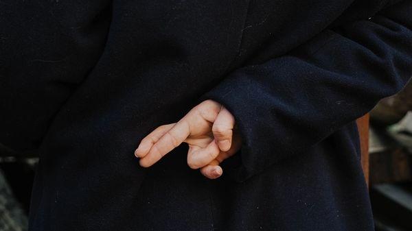 Crossing fingers