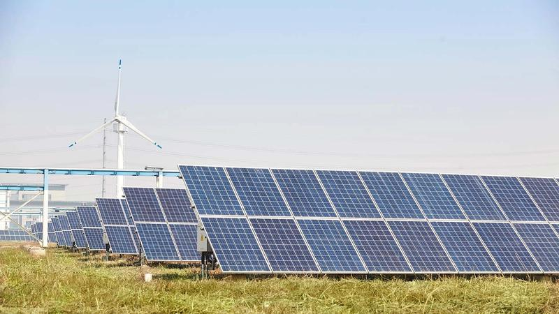 Solar panels and wind power, two key sources of green electricity used by Unilever