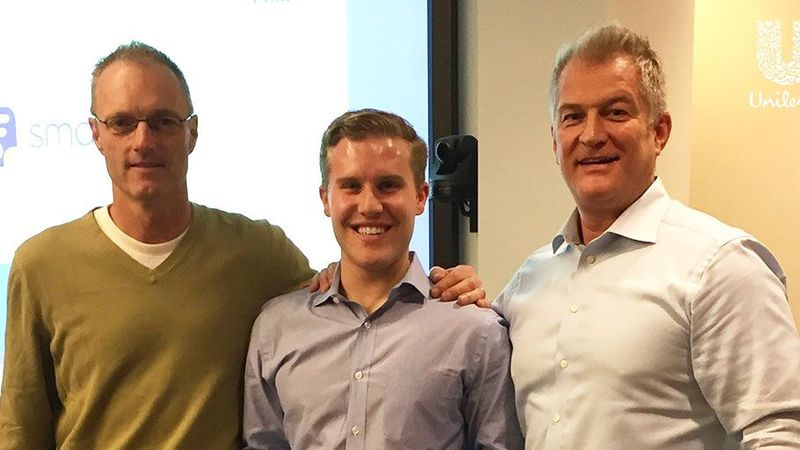 Todd Tillemans, standing with 2 male employees