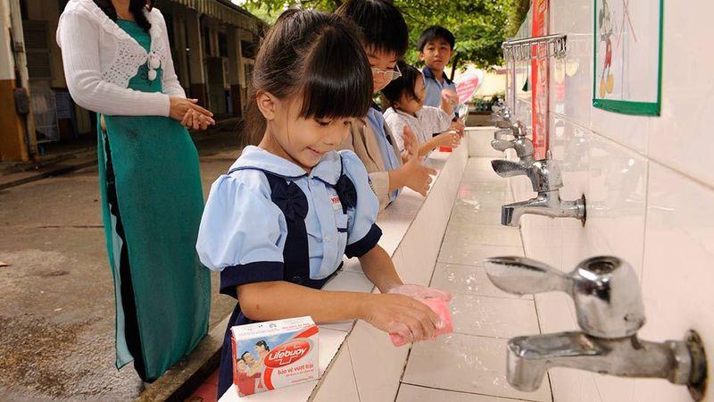 Girl washing hands using Lifebuoy