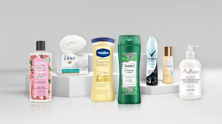 An assortment of Unilever brand products, including Dove soap, Love Beauty and Planet bodywash, and Suave shampoo.