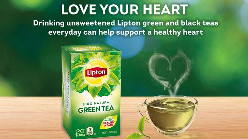 A pack of Lipton's Green Tea alongside a glass cup of tea with heart-shaped steam, with strapline Love your Heart