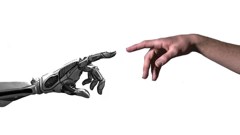 A robotic arm and a human arm