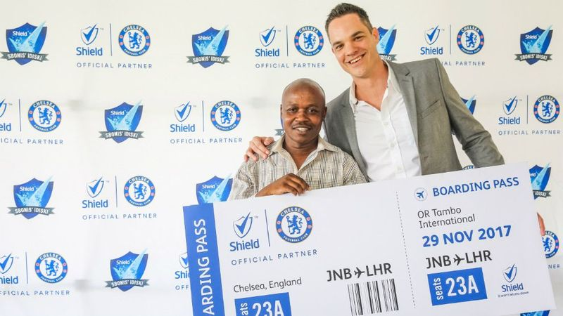Two men holding Shield Award