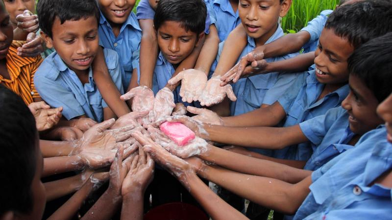 Children washing their hands with LifeBuoy soap
