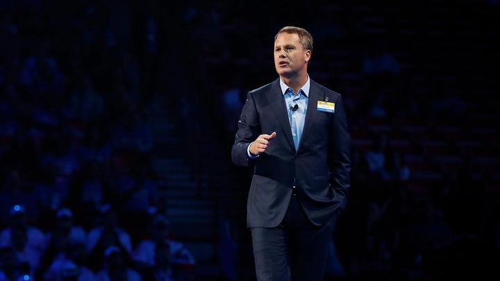 Doug McMillon, Walmart CEO, speaking on stage in front of an audience