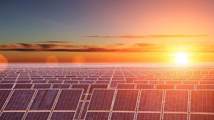 Solar panels against a sunset