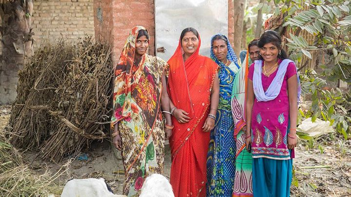 Group of Asian women outside toilet facilities