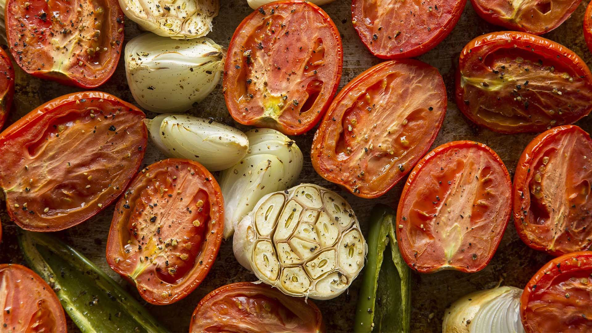 Tomatoes and Onions being cooked on a grill pan